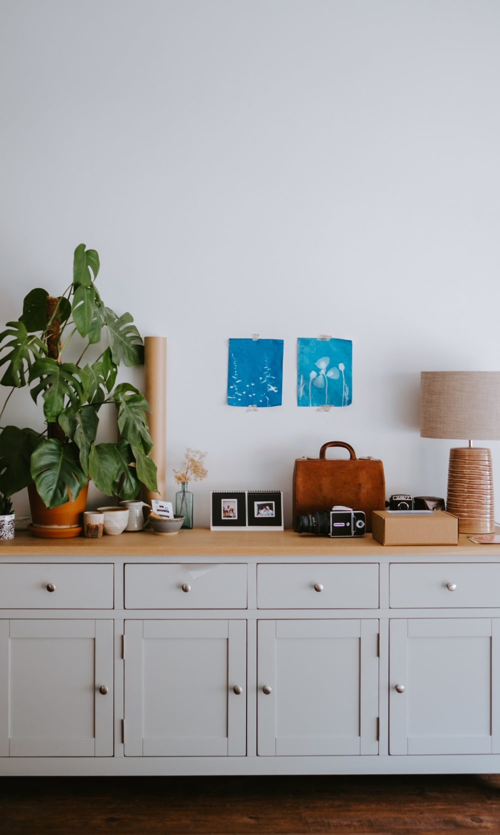 Style a sideboard with pictures, plants, accessories and lighting 3
